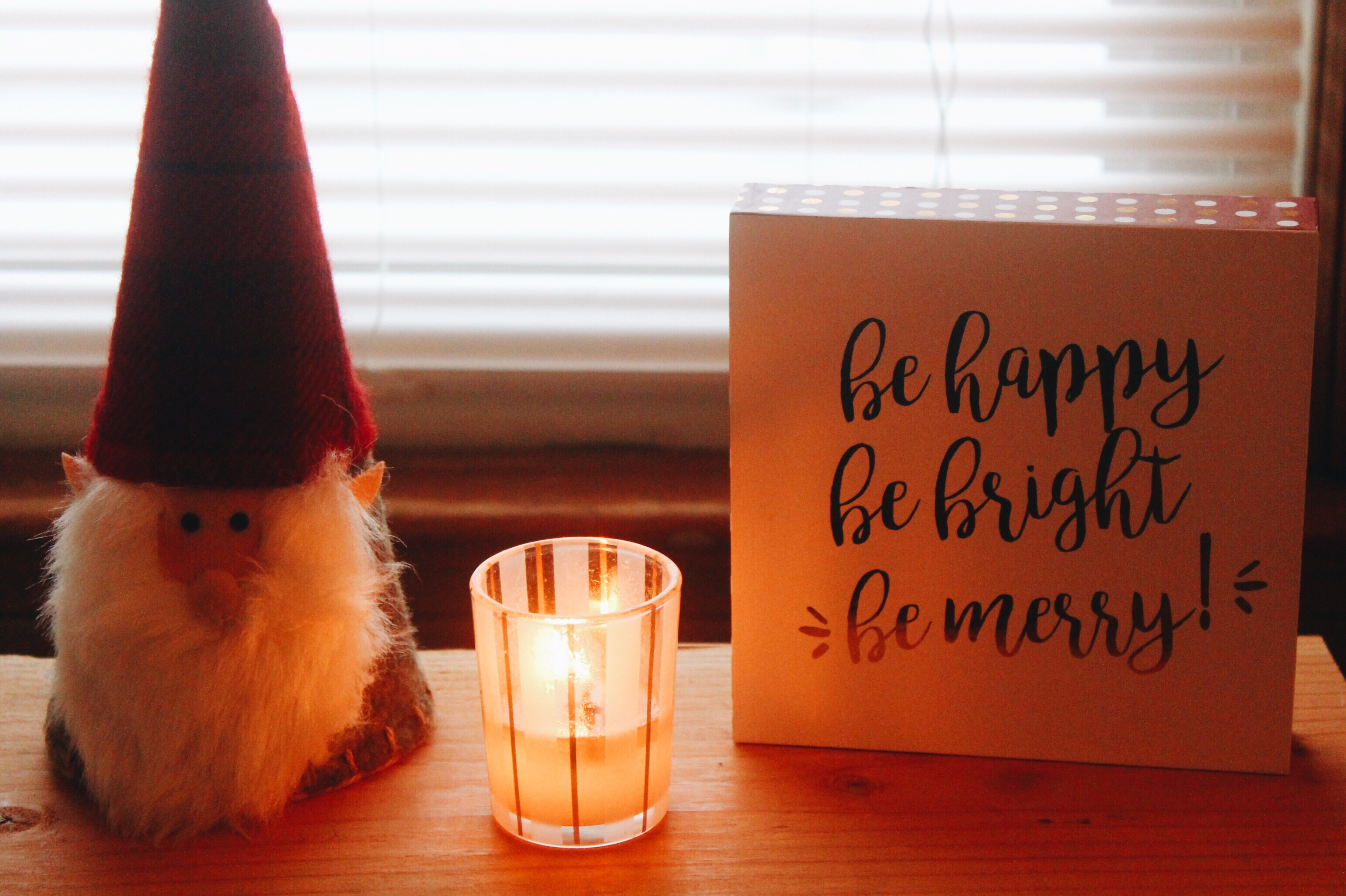 Santa from thrift store, mini Nest Holiday candle, sign from Home Goods